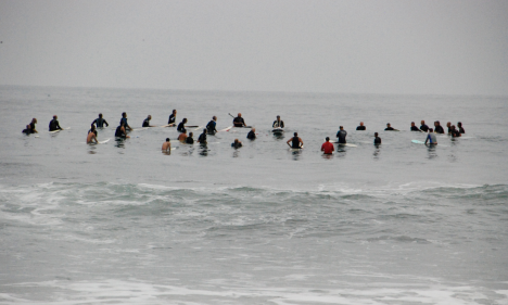 Surf buddies paddle out for last respects.